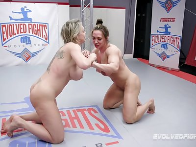 After the catfight Brandi Mae uses a strapon to fuck Dee Williams